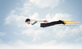 Happy business man flying fast on the sky between clouds Royalty Free Stock Photography
