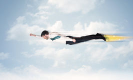 Happy business man flying fast on the sky between clouds Stock Images