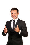 Happy business man going thumbs up. Young happy business man going thumbs up, isolated on white royalty free stock photo