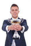 Happy business man handing a trophy Royalty Free Stock Image