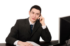 Business man sitting at desk talking on the phone. Royalty Free Stock Photos