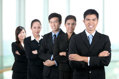 Happy business man and his team Royalty Free Stock Images