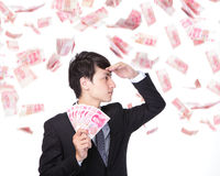 Happy business man hold China money Royalty Free Stock Photography