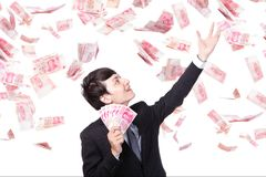 Happy business man hold China money Royalty Free Stock Photos