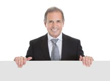 Happy business man holding blank placard Royalty Free Stock Image