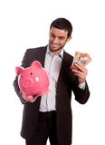 Happy business man holding piggy bank with Australian Dollars. Vertical portrait of a Happy business man smiling at the camera wearing a suit and holding a piggy Stock Images