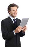 Happy business man holding a tablet reader. Isolated on a white background Stock Photos