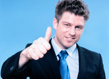 Happy business man holding thumbs up Stock Images