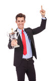 Happy business man holding a trophy Royalty Free Stock Photo