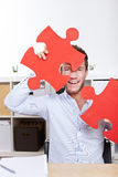 Happy business man with jigsaw Royalty Free Stock Photography