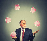 Happy business man juggling money Royalty Free Stock Photo