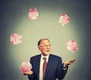 Happy business man juggling money. Mature happy business man juggling money Royalty Free Stock Photo