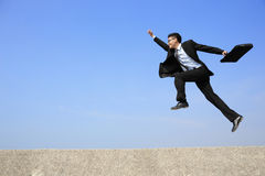 Happy business man jump Stock Photo