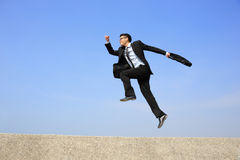 Happy business man jump Stock Photos