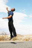 Happy business man jumping in the air Stock Photos