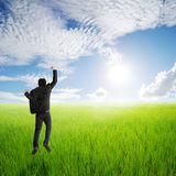 Happy business man jumping in green rice field and clouds sky Royalty Free Stock Images