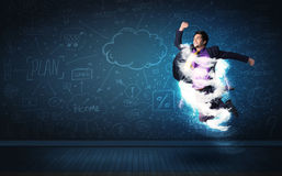 Happy business man jumping with storm cloud around him Royalty Free Stock Photos