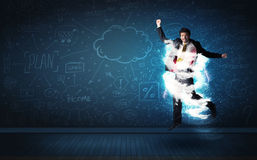 Happy business man jumping with storm cloud around him Stock Image
