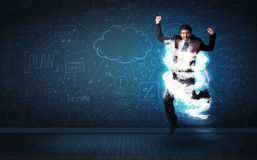 Happy business man jumping with storm cloud around him Royalty Free Stock Photo