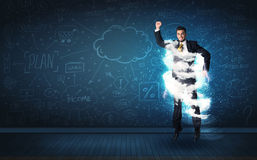 Happy business man jumping with storm cloud around him Stock Photo