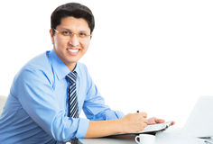 Happy business man with laptop Royalty Free Stock Image
