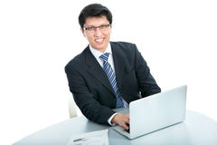 Happy business man with laptop Royalty Free Stock Photos