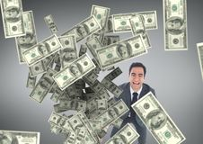 Happy business man looking at money rain against grey background Stock Photos