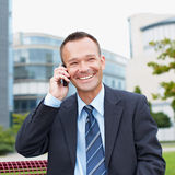 Happy business man making a call Royalty Free Stock Photos