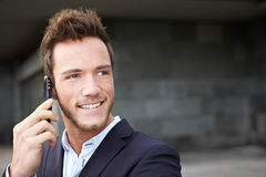 Happy business man making calls Royalty Free Stock Photo