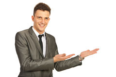 Happy business man making presentation. With both hands to copy space isolated on white background stock photography