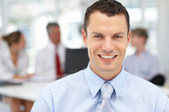 Happy business man in office. Smiling at camera Royalty Free Stock Images