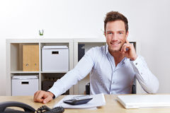 Happy business man in office at Royalty Free Stock Photo