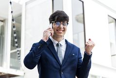 Happy business man on phone. With his boss Royalty Free Stock Photography