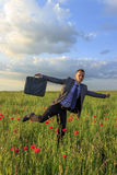 Happy business man in the poppy field Royalty Free Stock Images