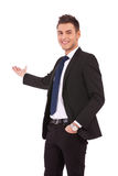 Happy business man presenting Stock Images