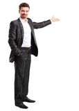 Happy business man presenting and showing with copy space for your text Stock Photography