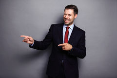 Happy business man presenting and showing with copy space Stock Images