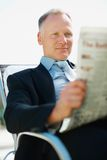 Happy business man reading a newspaper Stock Photo