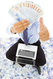 Happy business man showing the money and thumb up Royalty Free Stock Photos