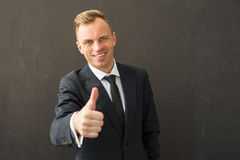 Happy business man showing thumb up Royalty Free Stock Images