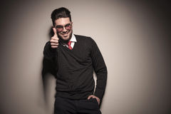 Happy business man showing the thumbs up sign. Stock Photography