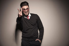 Happy business man showing the victory sign Stock Photos
