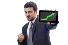 Happy Business man shows rising graph. On tablet pc screen royalty free stock image