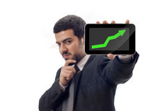 Happy Business man shows rising graph Royalty Free Stock Photo