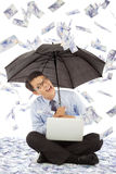 Happy business man sitting on floor and holding a umbrella Royalty Free Stock Photos