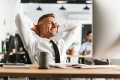 Free Happy Business Man Sitting In Office Working With Computer Have A Rest. Royalty Free Stock Photos - 127289818