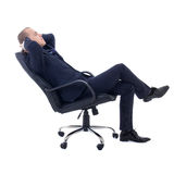 Happy business man sitting on office chair isolated on white. Background stock photo