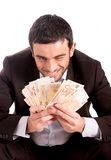Happy business man sitting on piggy bank counting money euros Royalty Free Stock Photography