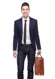 Happy business man smiling with bag Royalty Free Stock Image