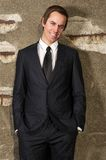 Happy business man smiling outdoors in relaxed pose stock images